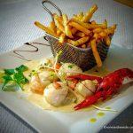 Poêlée de St Jacques flambée au restaurant au Havre