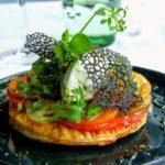 Tarte fine de tomates et bruccio corse, servie froide. au restaurant Margote au Havre