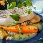 Lieu jaune, nage de lentilles corail et brunoise d'andouille et ciboulette. au restaurant Bouche à Oreille au Havre